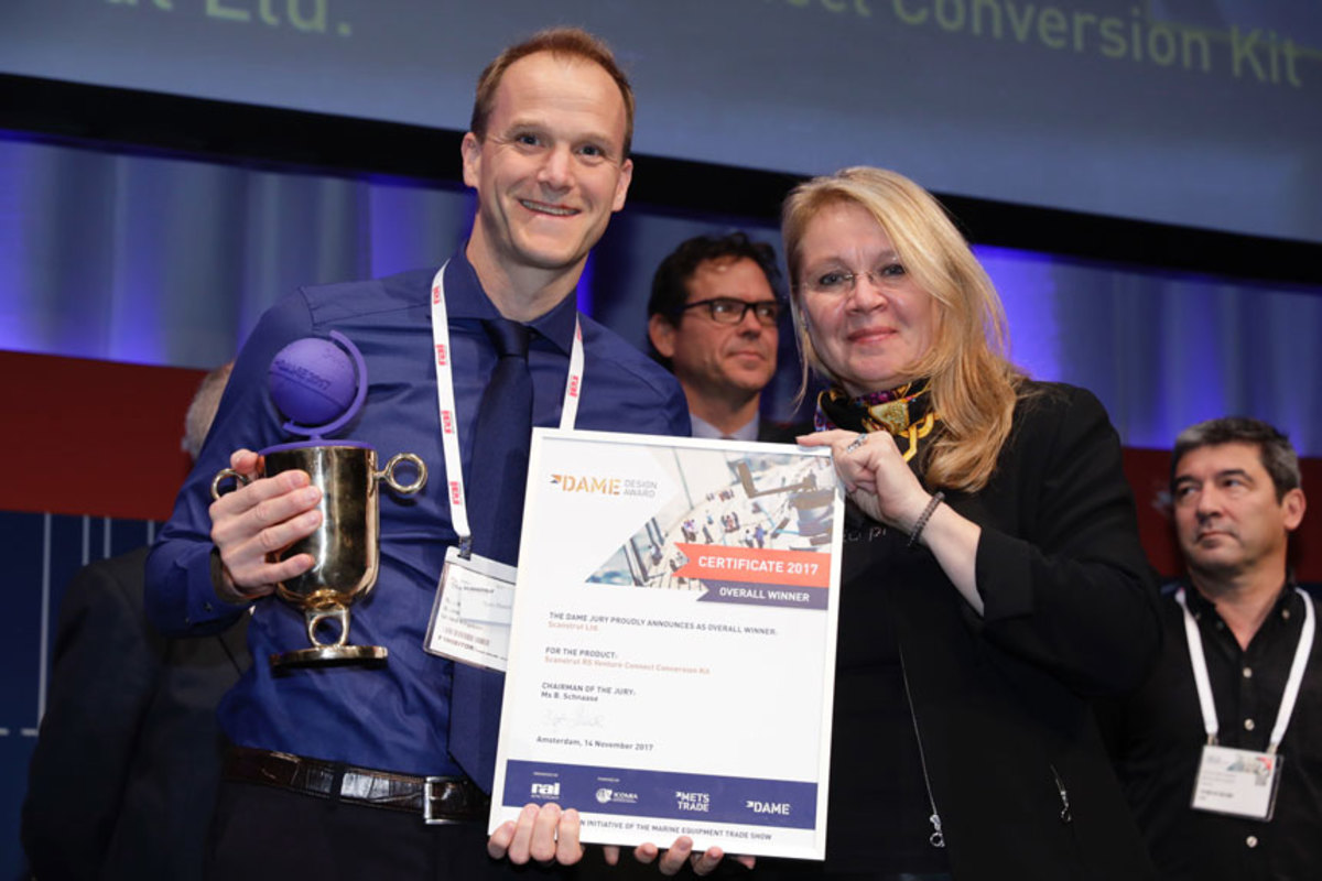 Birgit Schnaase, chairwoman of the DAME jury, is shown with Tom Reed of Scanstrut, which received the DAME Design Award 2017 today at the Metstrade show in Amsterdam.