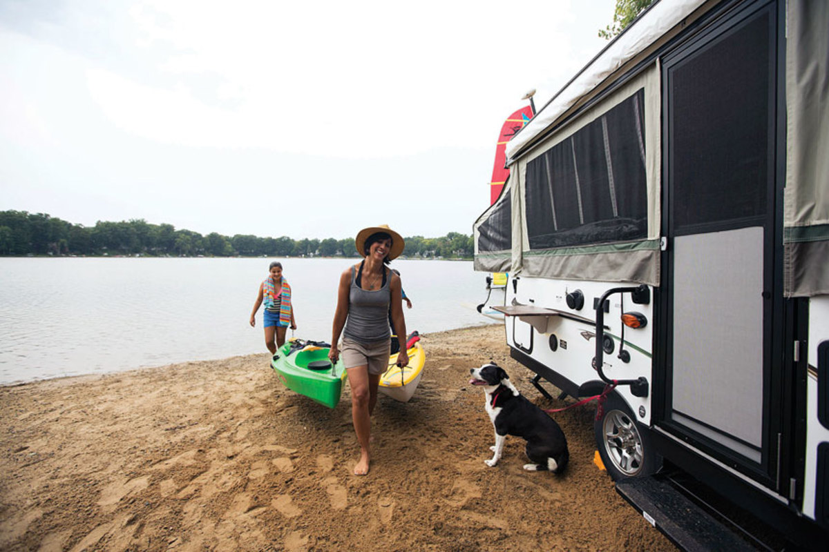Having an RV on the shoreline gives kayakers a base camp.