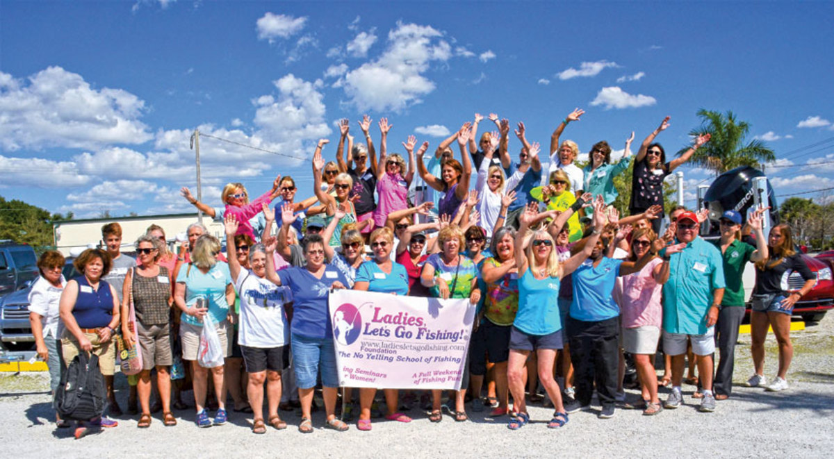 Florida Gulf Coast participants celebrate their graduation from an LLGF fishing class. Bauman is in front of the group, at right.