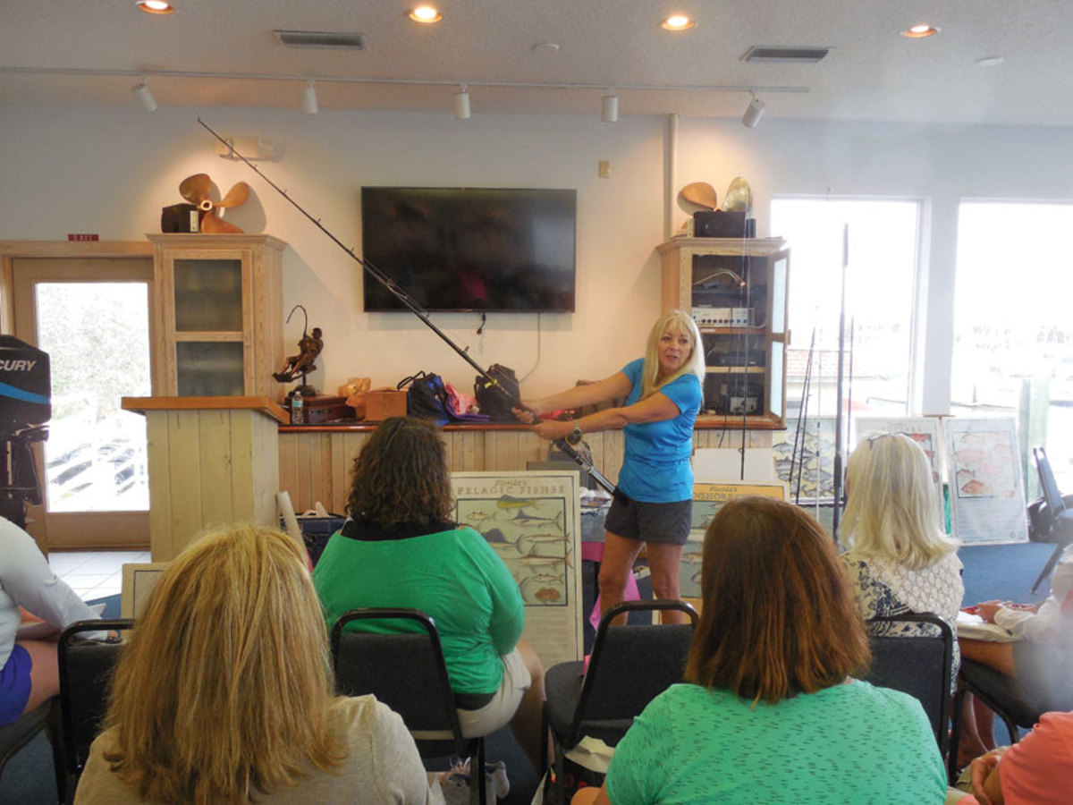 Bauman shows a group of women how to hold a rod during a fishing class at the Northeast Florida Marlin Association in St. Augustine, Fla. She had her first event in 1997. Eight thousand women have graduated from Bauman's school.