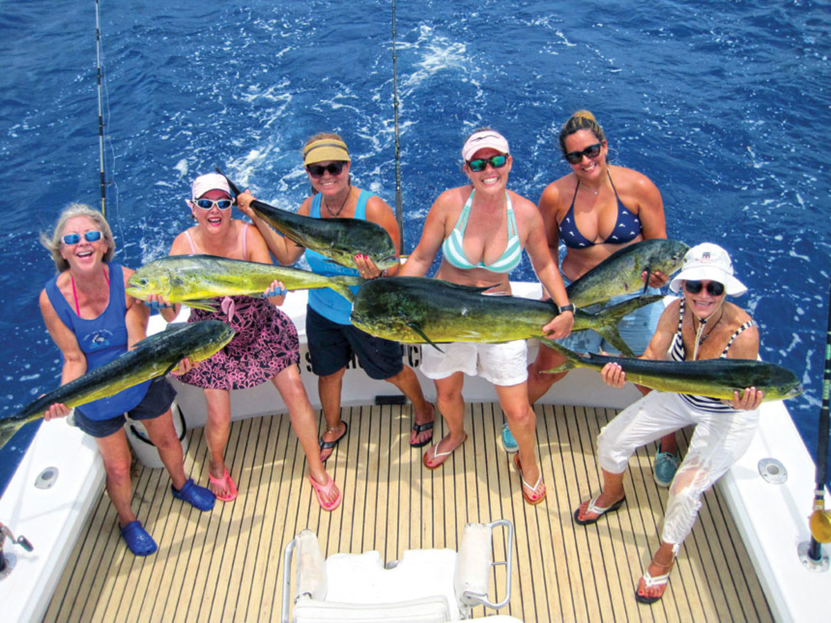 Women participating in an LLGF outing in Islamorada, Fla., hold the mahi-mahi they caught.