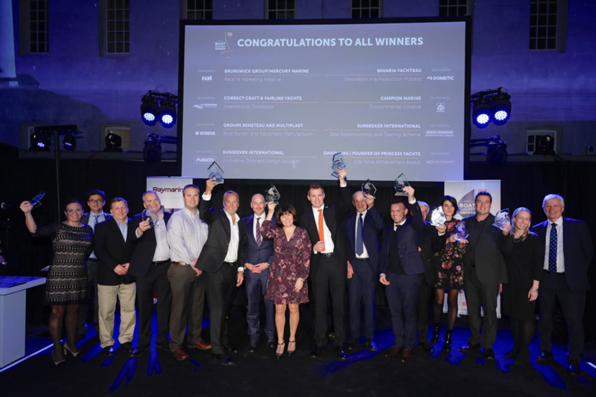 Winners of the Boat Builder Awards for Business Achievement celebrate the honor.