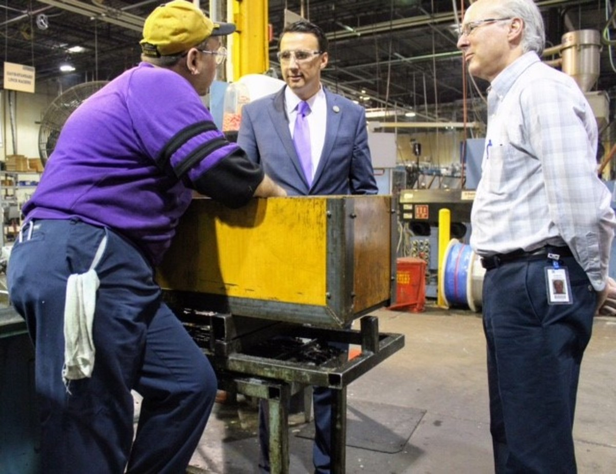 U.S. Rep. Ryan Costello, R-Pa., (center) was given a tour by SeaStar Solutions plant manager Robert James (right) last week. Rick Hornberger, vice chairman of United Auto Workers Local 644, was among the employees that Costello met during his visit.