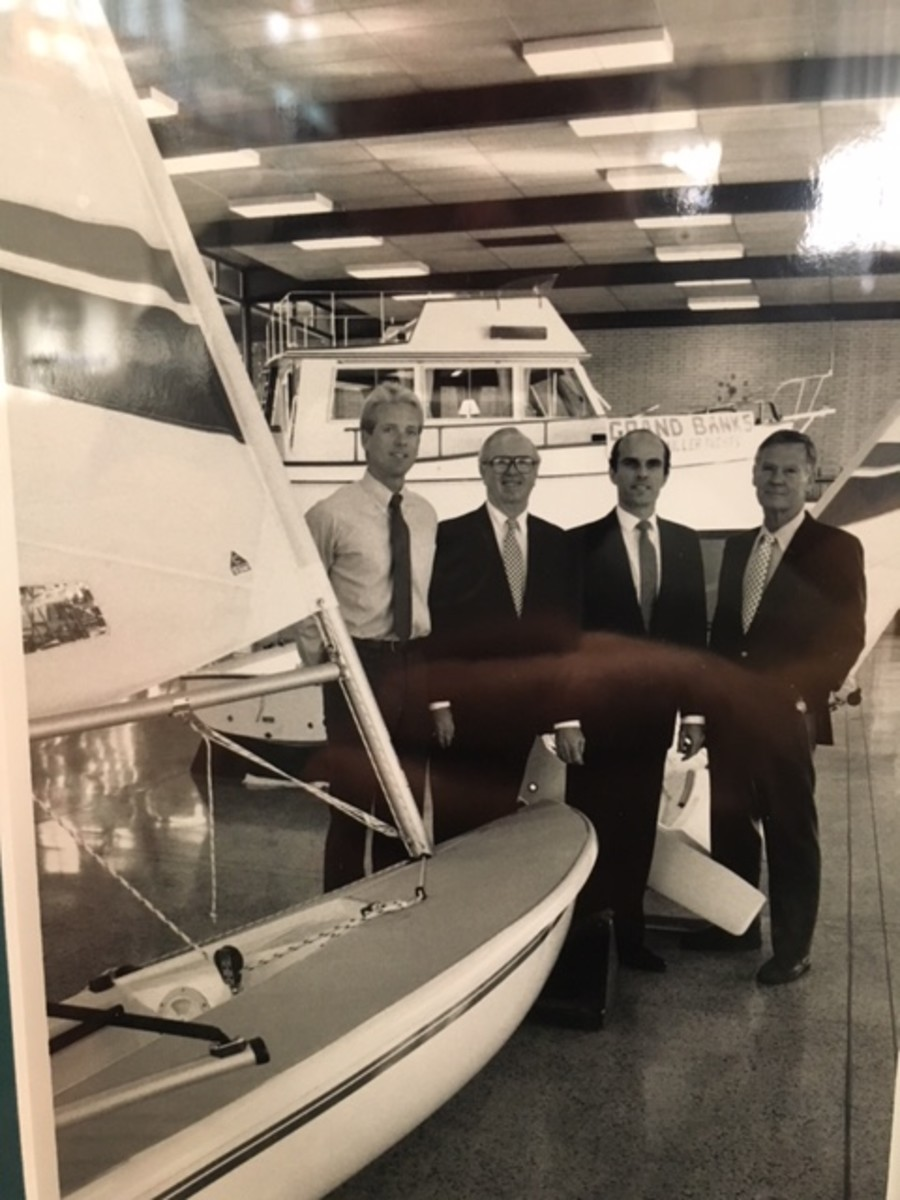 Brad Buettner (left) and Stan Miller (right) meet with representatives of Coast Bank at the Stan Miller Yachts showroom in 1987. James Lynch and Jim Wulschleger of the bank are second and third from left.