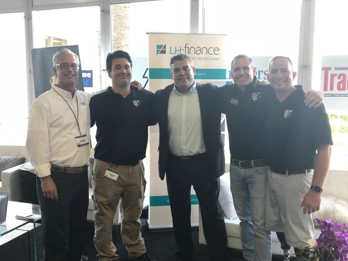Gary DeSanctis (left), Active Interest Media Marine Group publisher and general manager, is shown with his son Louie, who helped conduct outreach in Houston with Sheep Dog Impact Assistance after Hurricane Harvey; LH-Finance president and CEO Hervé Bonnet; and Michael Nimmo and Scott West, both of SDIA.