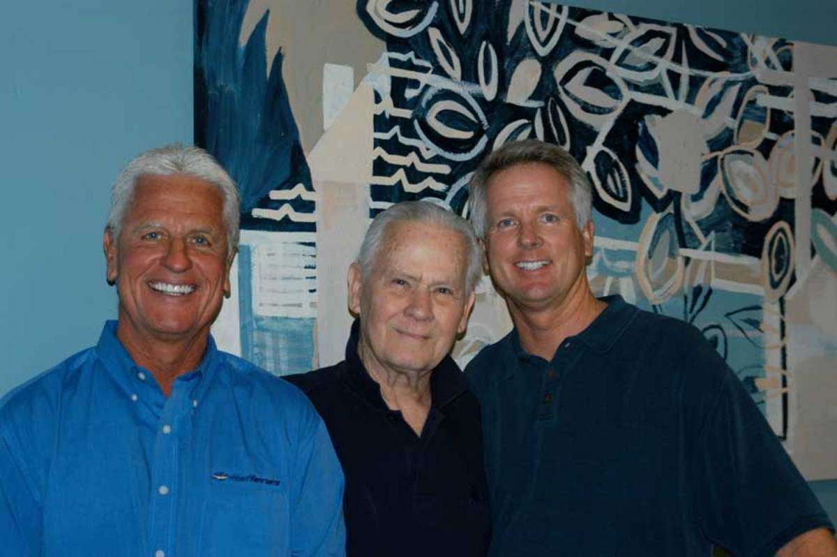 Stan Miller (center) is shown with John Buettner (left) and Buettner's brother Brad in May 2008 at the Stan Miller Yachts office in Long Beach, Calif.