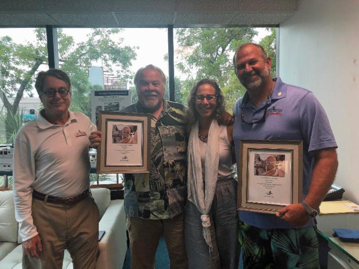 Andrew Cilla (left), president of the Freedom Waters Foundation, is shown with new board members Jim Sacks (second from left), and Ron McTighe, of Luke Brown Yachts. Debra Frenkel, executive director and a co-founder of the organization, is also shown.
