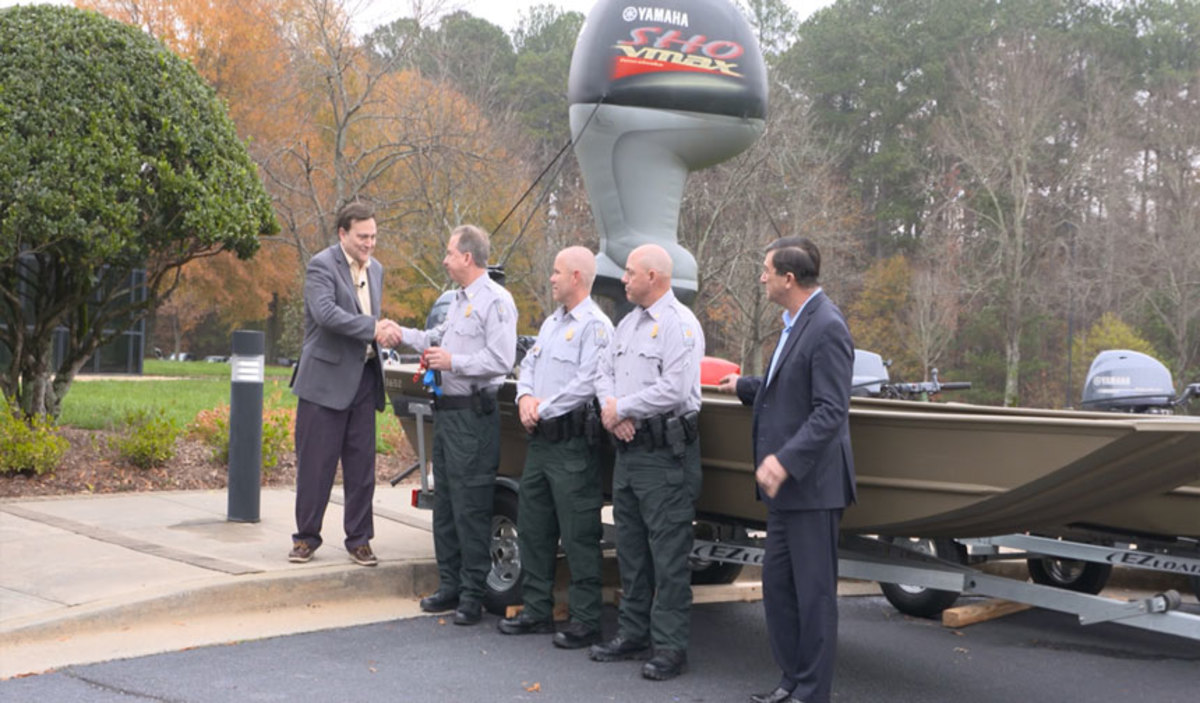 Yamaha Marine Group President Ben Speciale (left) presents Col. Eddie Henderson (second from left) of the Georgia Department of Natural Resources with four G3 boats powered by Yamaha 4-stroke outboards. Others shown are DNR Cpl. Bart Hendrix; DNR Sgt. Jason Roberson; and Martin Peters, manager of government relations for the Yamaha Marine Group.
