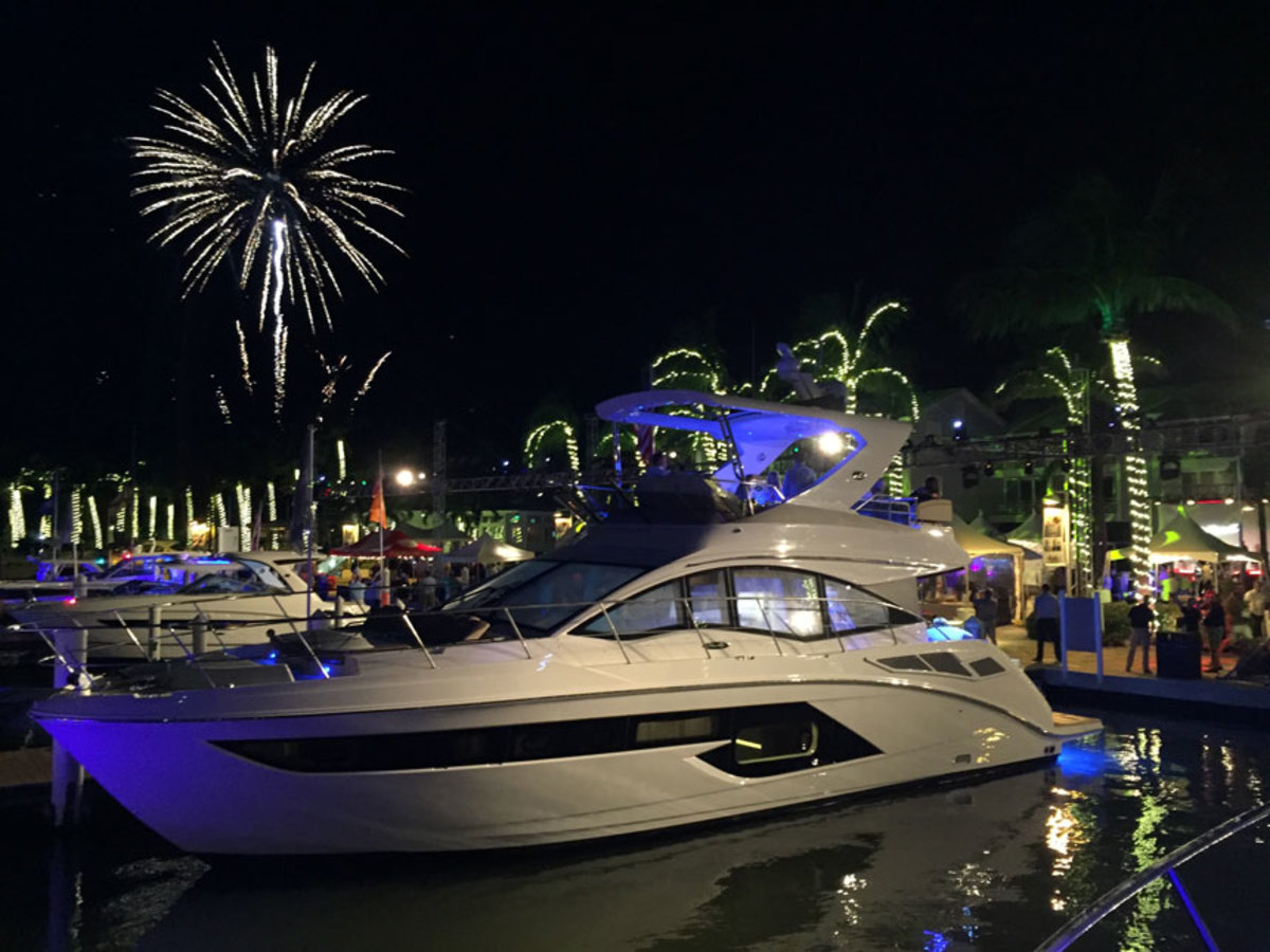 A Sea Ray 520 Fly is shown during a fireworks display at the Yacht Expo on Saturday night.