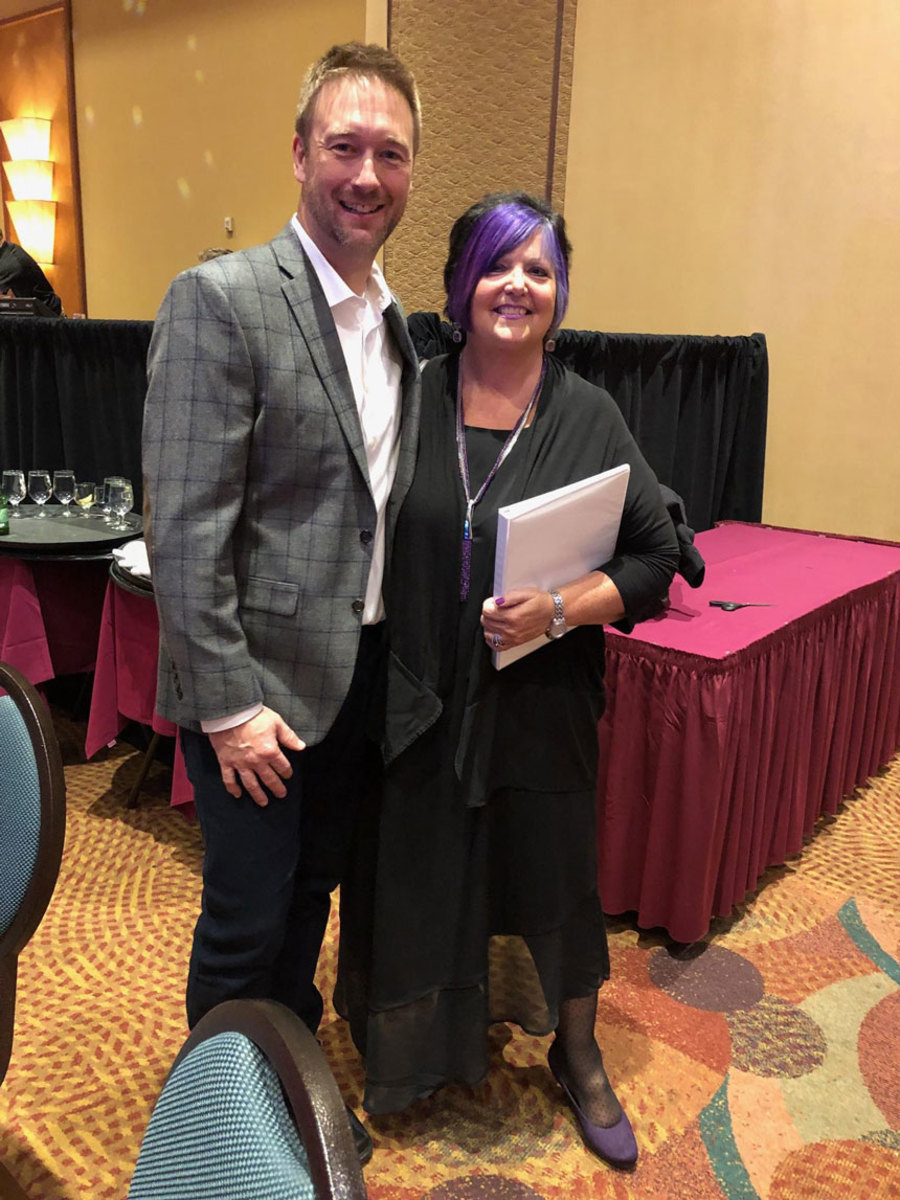 Wanda Kenton Smith, who received the Darlene Briggs Woman of the Year Award, is shown with Matt Gruhn, president of the Marine Retailers Association of the Americas.