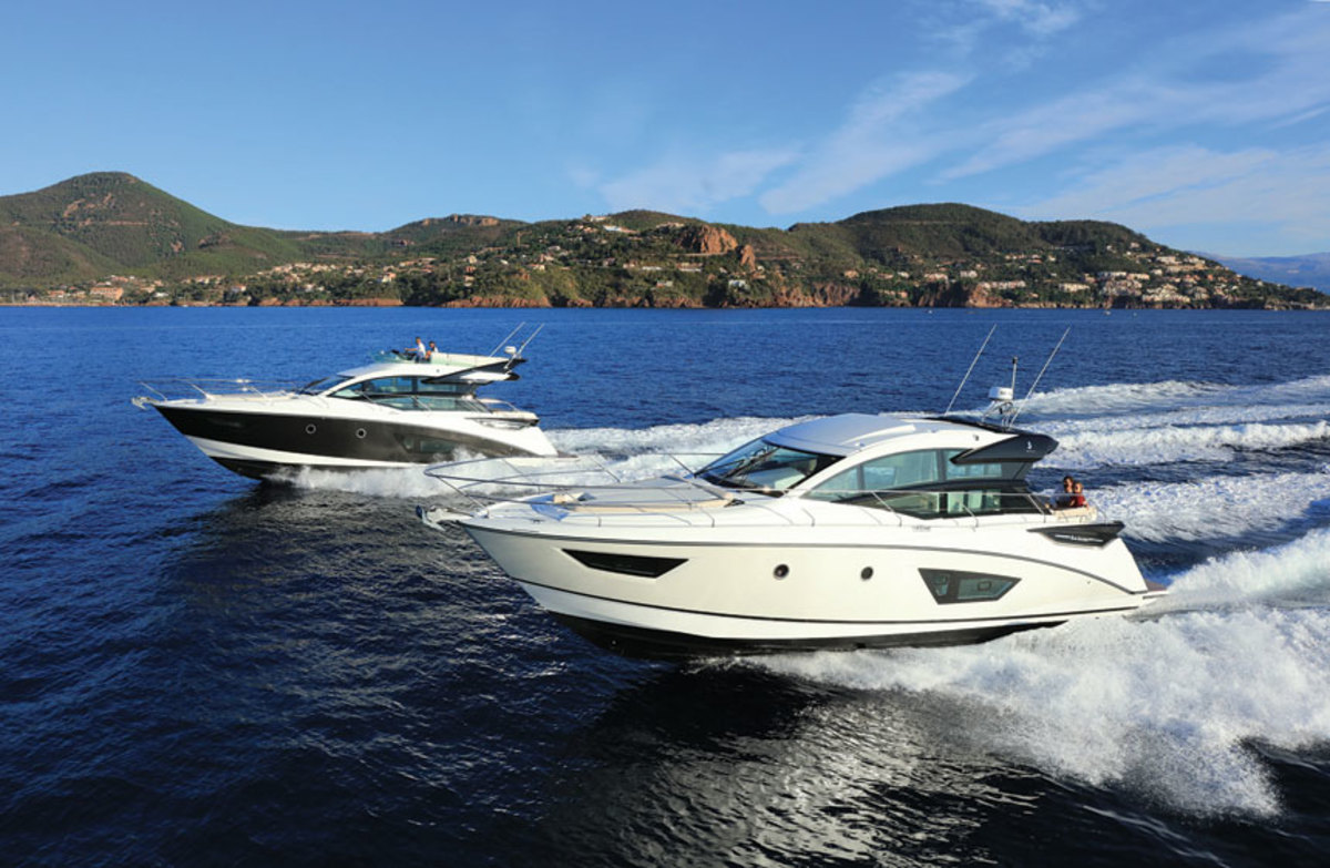 Beneteau builds fiberglass boats from 16 to 105 feet. Shown is a Gran Turismo 50 (foreground) and a Gran Turismo 50 Sportfly.