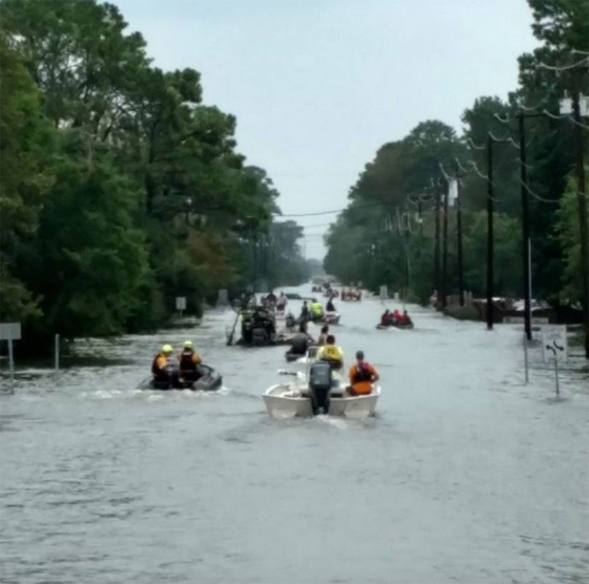 Kyle Holmes took this photo of boaters rescuing people from floods as Hurricane Harvey dumped more than 50 inches of rain in some parts of Houston.