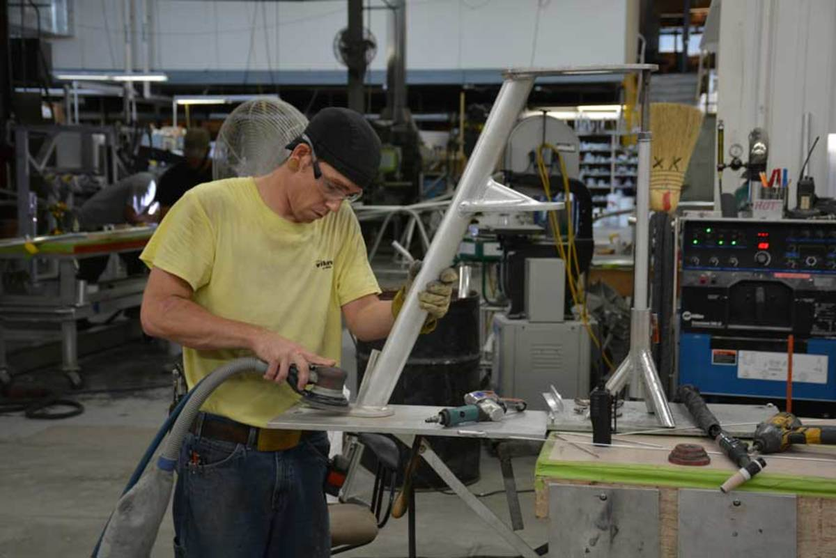 The boating industry, like most, is experiencing a vast shortage of skilled laborers in the service and manufacturing sectors. (Shown here is a worker at the Viking Yachts plant in New Jersey.) California is spending millions to rebrand the vocational trades.