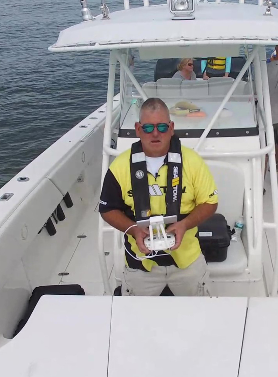 Sea Tow Central Connecticut owner Tom Kehlenbach pilots his DJI Phantom 4 from aboard a vessel. Kehlenbach uses the drone to make work safer and more efficient for himself and his crew.