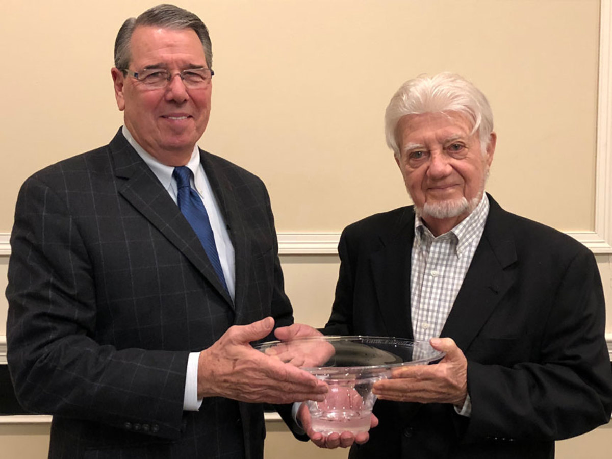 "Larry Russo (left), of MarineMax Russo, presented the Frank Farrell Award to Richard ""Dick"" Egan of Crosby Yacht Yard during the Massachusetts Marine Trade Association's annual conference."