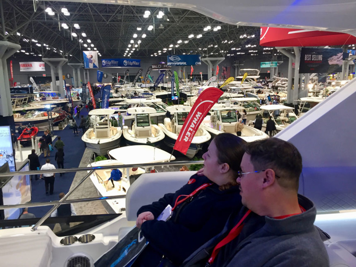 Two visitors look out onto the floor of the show from a Sea Ray 460 Sundancer in this photo from the 2017 event.