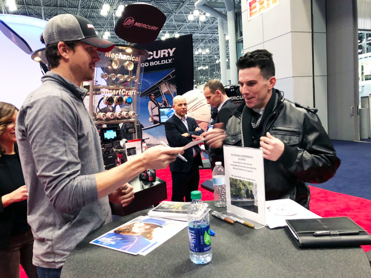 New York Mets pitcher Jacob deGrom (left) met with fans in the Mercury Marine booth.