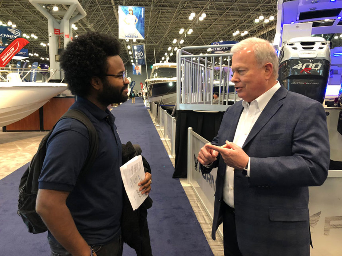 NMMA president Thom Dammrich talks with student Eric Soto.