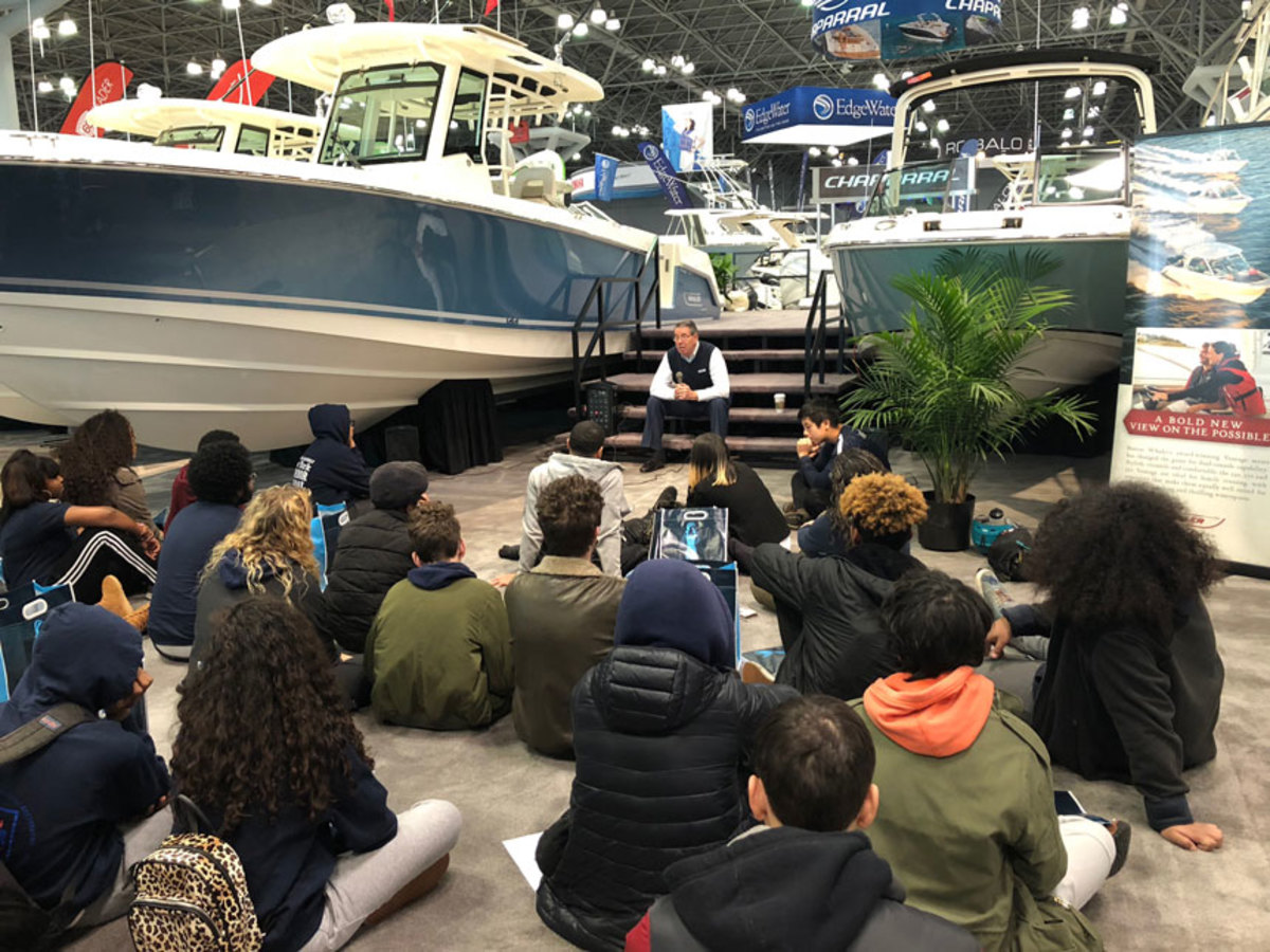 Larry Russo of MarineMax Russo speaks Thursday to some of the 100 New York-area high school students who gathered for the Progressive New York International Boat Show's first career day.