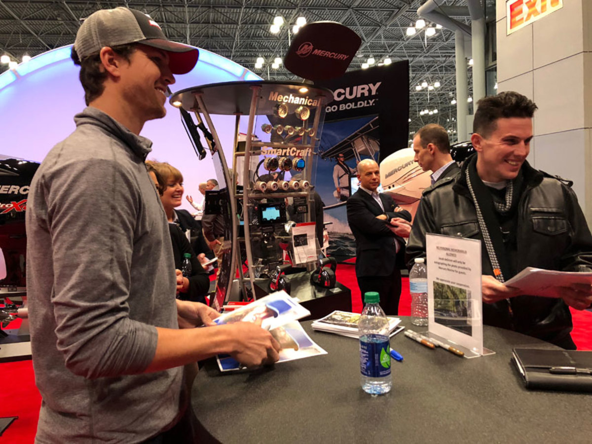 New York Mets pitcher Jacob deGrom signed autographs for fans in the Mercury booth at the Progressive New York International Boat Show on Thursday.