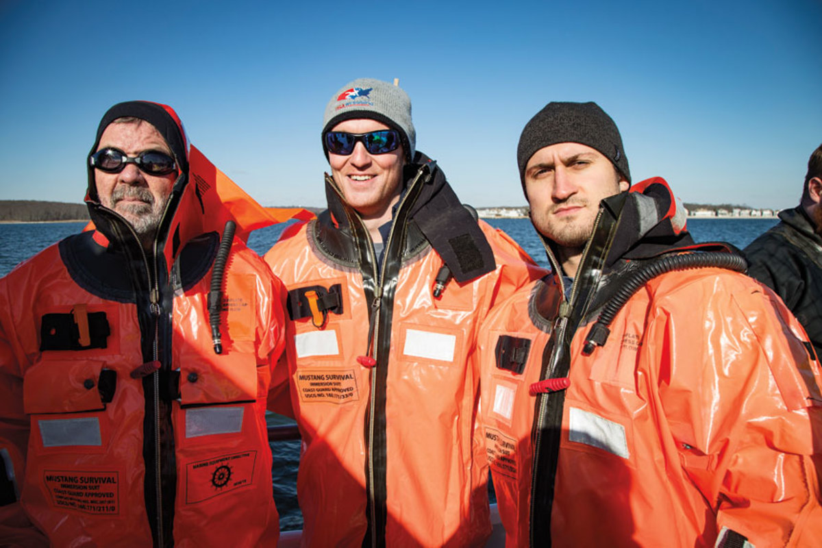 The safety-at-sea team included (from left) Bill Sisson of Trade Only and Daniel Harding Jr. and Simon Murray of Power & Motoryacht magazine.