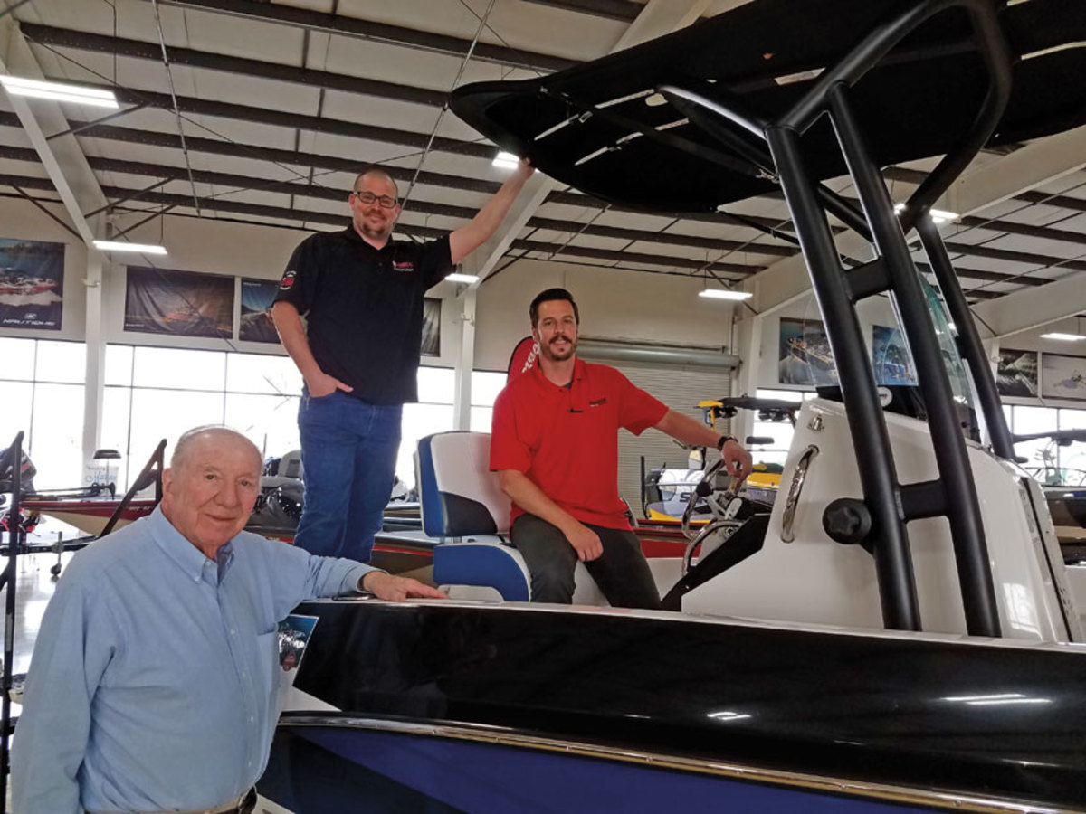Galey, foreground, with his grandsons Jeff and Steve Pinheiro who run the sales and service departments at the dealership.