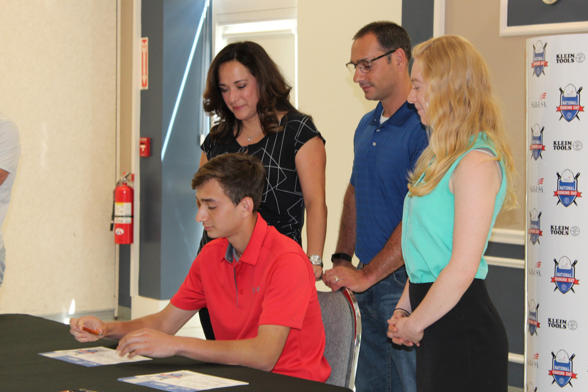 Student Nick Gagnon was recognized while his parents Keith (center) and Jessica Gagnon (left) watched. Workforce development coordinator Lia Jaros is pictured on the right.