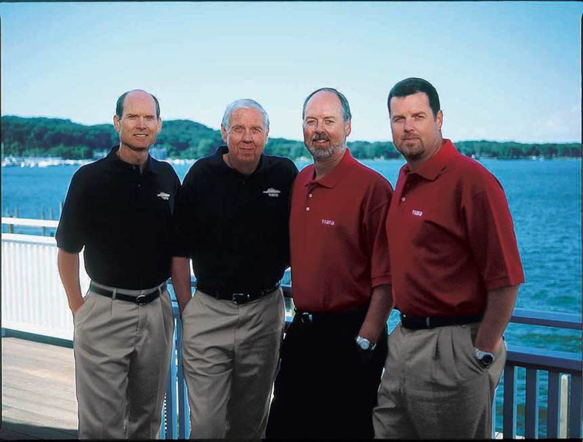 Leon Slikkers with sons (from left) Bob, David and Tom in the late 1990s.