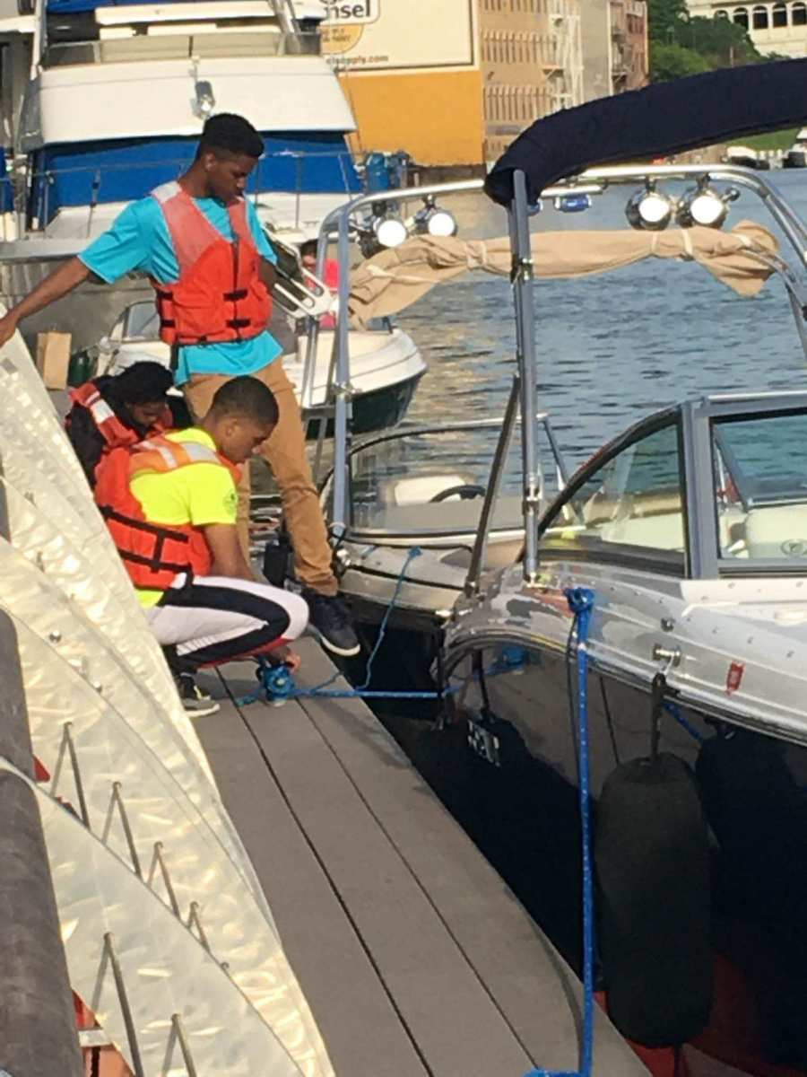 Students in the program help tie up and move boats.