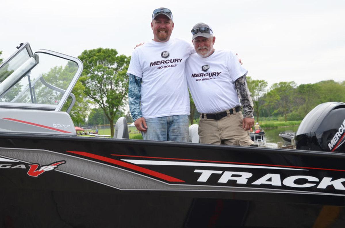 Matthew (left) and Kurt Stobbe and their new Tracker boat.
