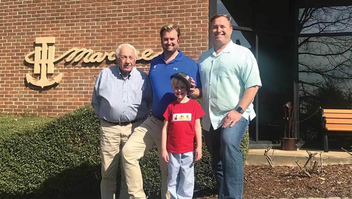 Four generations of Huntleys (from left): Bill, Jeffery Jr., Jeffery III and Jeff. Jeffery III has grown up on the water.