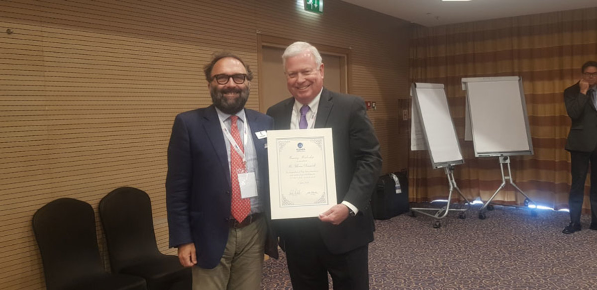 ICOMIA president Andrea Razeto presents past president Dr. Thomas Dammrich with honorary membership.