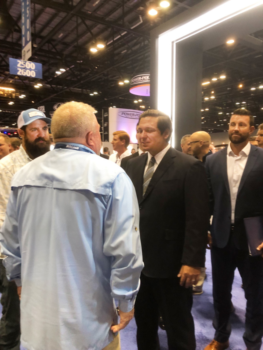 Florida Governor Ron DeSantis meets exhibitors on the show floor at ICAST.