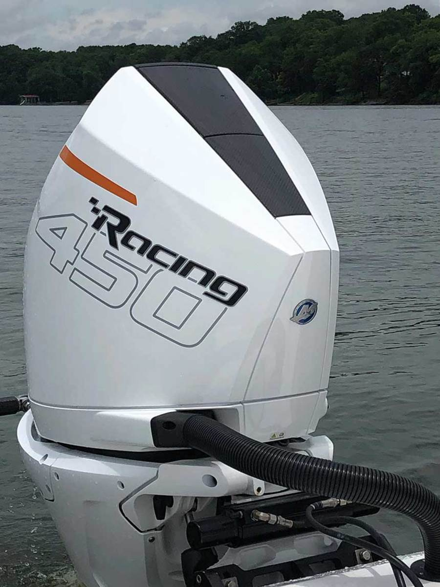 The 450R's narrow powerhead allows it to fit under the same cowling as the 300R.