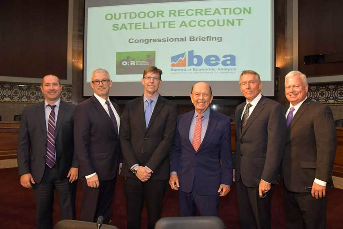 Members of the Outdoor Industry Roundtable, including Hugelmeyer (second from left) and Thom Dammrich (far right) meet with U.S. Secretary of Commerce Wilbur Ross (center).
