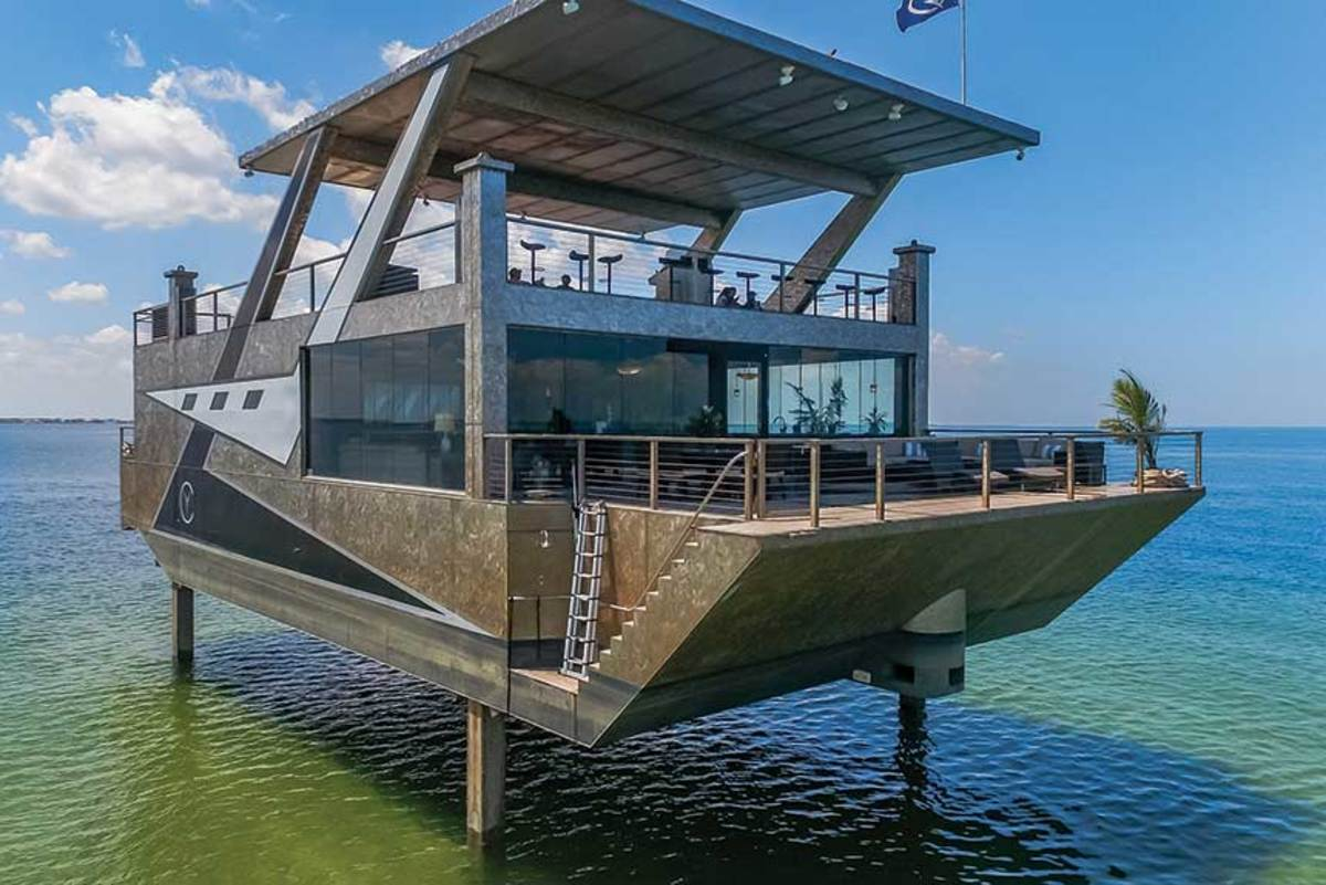"The 84-by-40-foot Cubic steel ""mansion yacht"" will be used for VIP gatherings at the show. The custom vessel rises above the water on hydraulic legs."