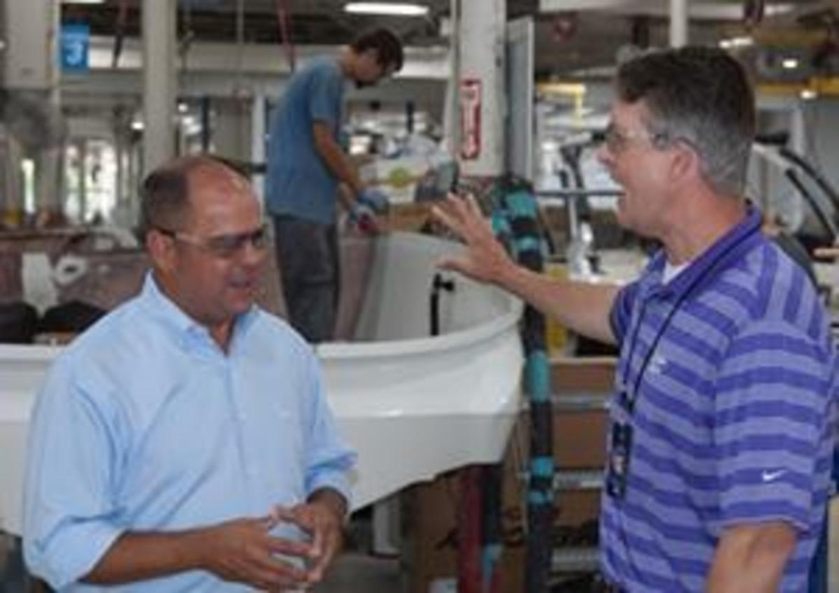 Left, Shane Stanfill, president of Cobalt Boats, discusses the manufacturing processes with Congressman Marshal during the facility tour.