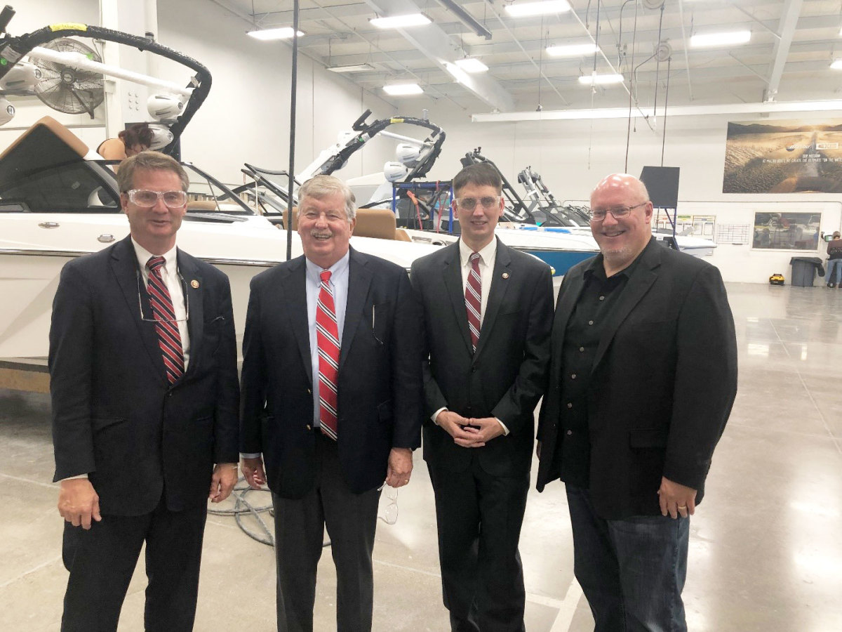 Photo caption (left to right): Rep. Tim Burchett, Lt. Gov. Randy McNally, State Rep. Lowell Russell, and Malibu Boats CEO Jack Springer.