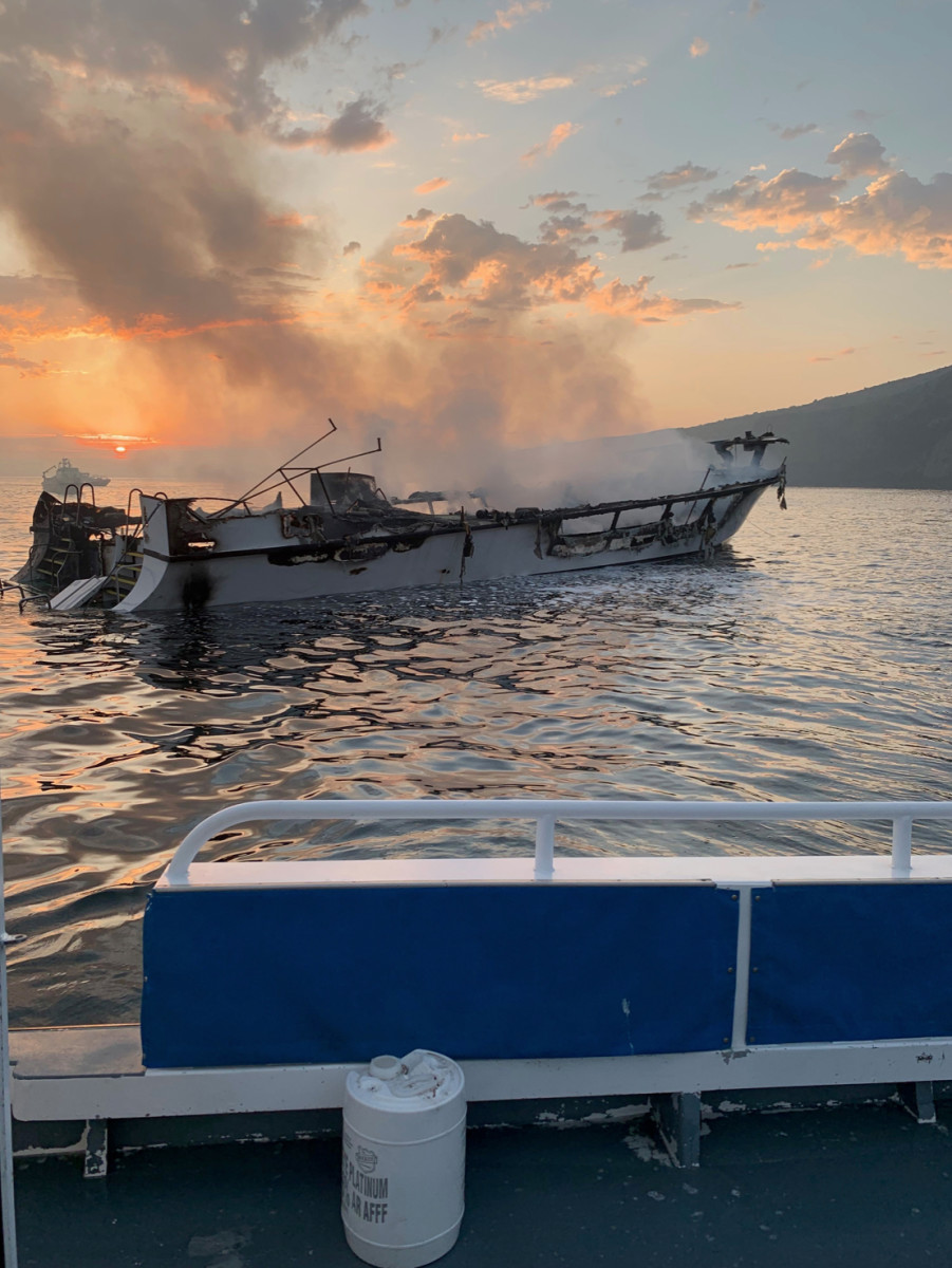 "The burned-out charter dive boat ""Conception"" just before sinking near the coast of Ventura County. Courtesy of the Ventura County Fire Department."