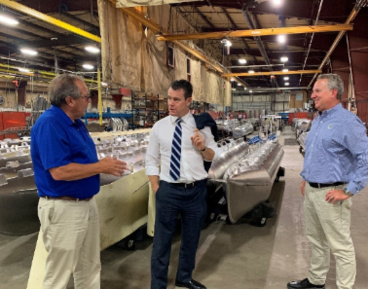 (Left to right), Smoker Craft president Doug Smoker, Senator Todd Young and Smoker Craft vice president of marketing and corporate development Peter Barrett discuss the finer points of pontoon construction.