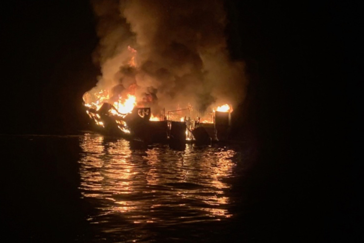 By the time rescue personnel arrived, the boat was engulfed in flames.
