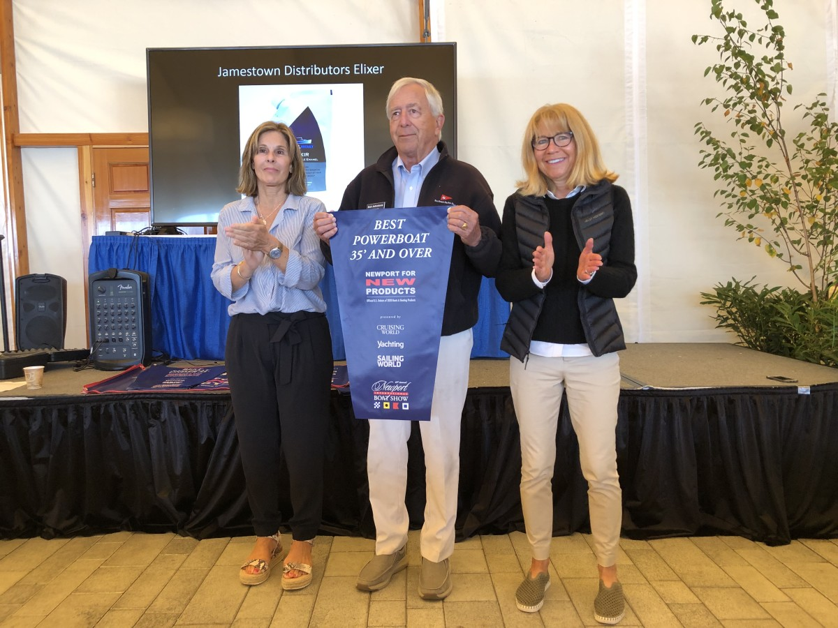 MJM Yachts founder Bob Johnstone (center) accepts the award on behalf of Boston BoatWorks cofounder Mark Lindsay, who died last week.