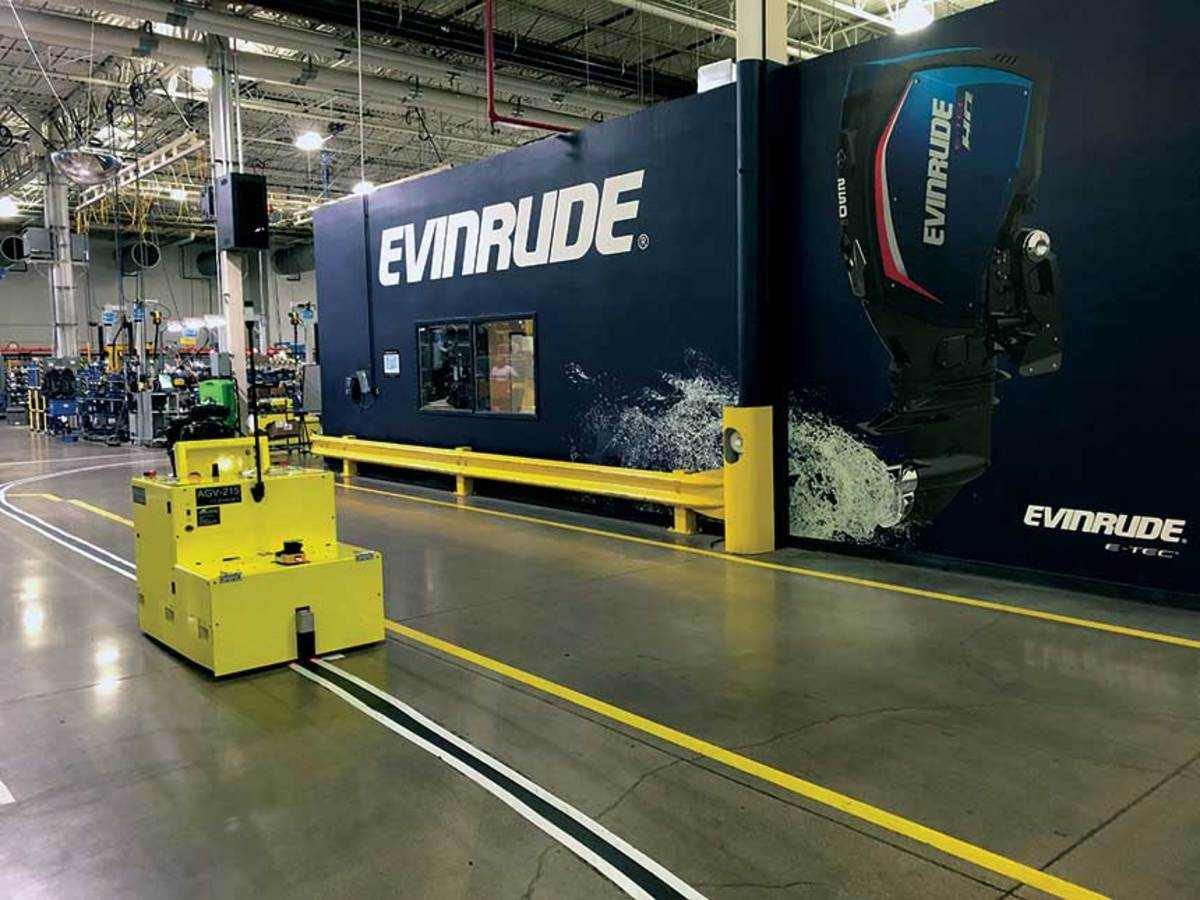 Instead of overhead conveyors, Evinrude uses automated guided vehicles to move engines through production.