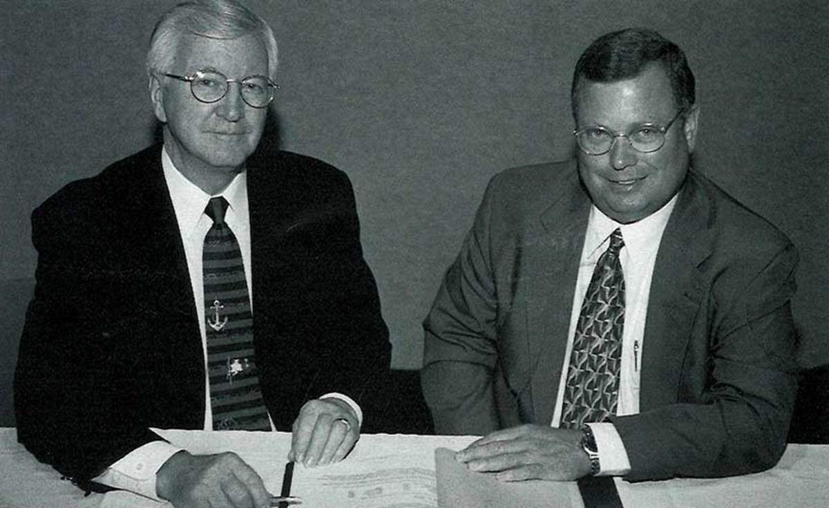 NMMA chairman Gayle McClure welcomes Thom Dammrich to his first IMTEC board meeting in 1999.