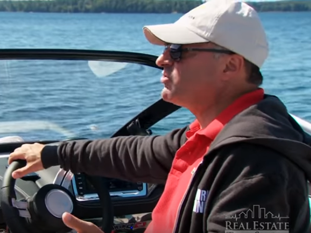 Kevin O'Leary at the wheel of one of his boats. (YouTube/Screengrab)