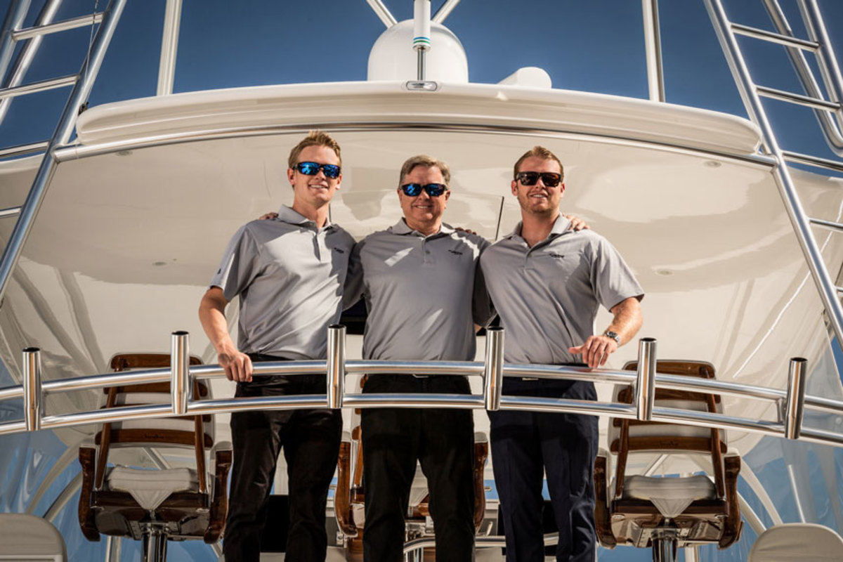 Viking Yacht president and CEO Pat Healey's sons, Justin (left) and Sean (right), are now part of the family business