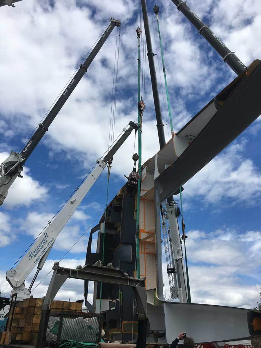 Goetz Composites built this  70-foot cataman using preimpregnated carbon fiber.  Here, it's being rolled over so construction can be completed.