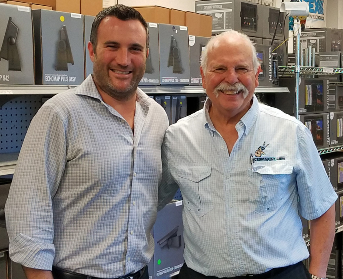 Longtime CED Marine owner Jules Rutstein (right) with new owner Gregory Borchardt.
