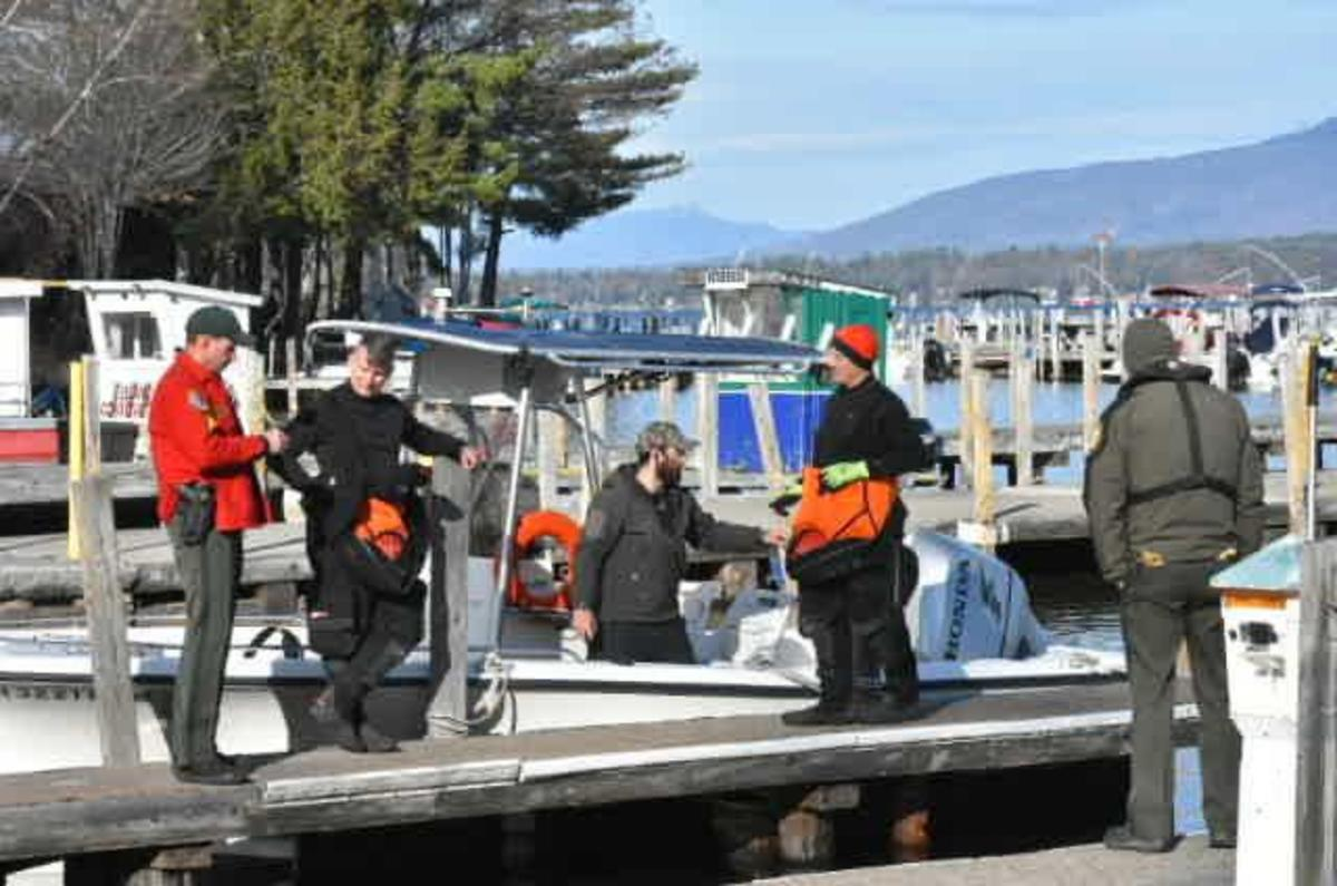 Divers from the New Hampshire Fish and Game department prepare to enter Lake Winnipesaukee. Photo by Bea Lewis, The Union Leader.