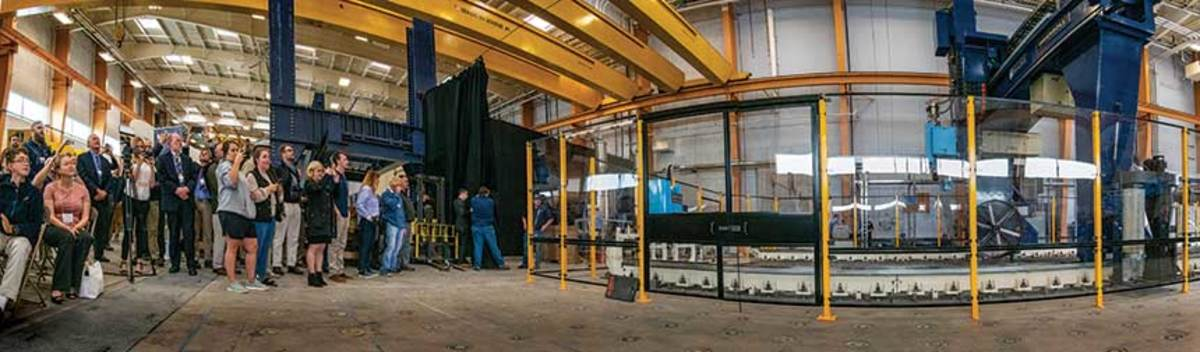 University of Maine's 3-D printer is the largest in the world, measuring 60 feet long, 22 feet wide and 10 feet tall. It can be stretched to 100 feet long.